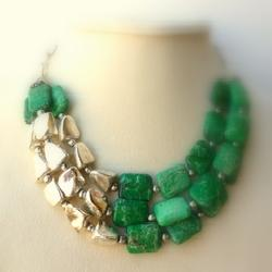 Handmade statement necklace adds flair.