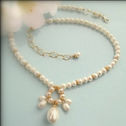 Pearls are strung by hand to create this beautiful piece.