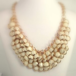 Handmade statement necklace adds personality to any outfit.